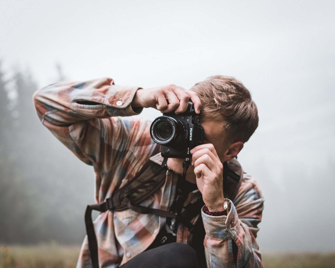 A man taking photos of a National Park