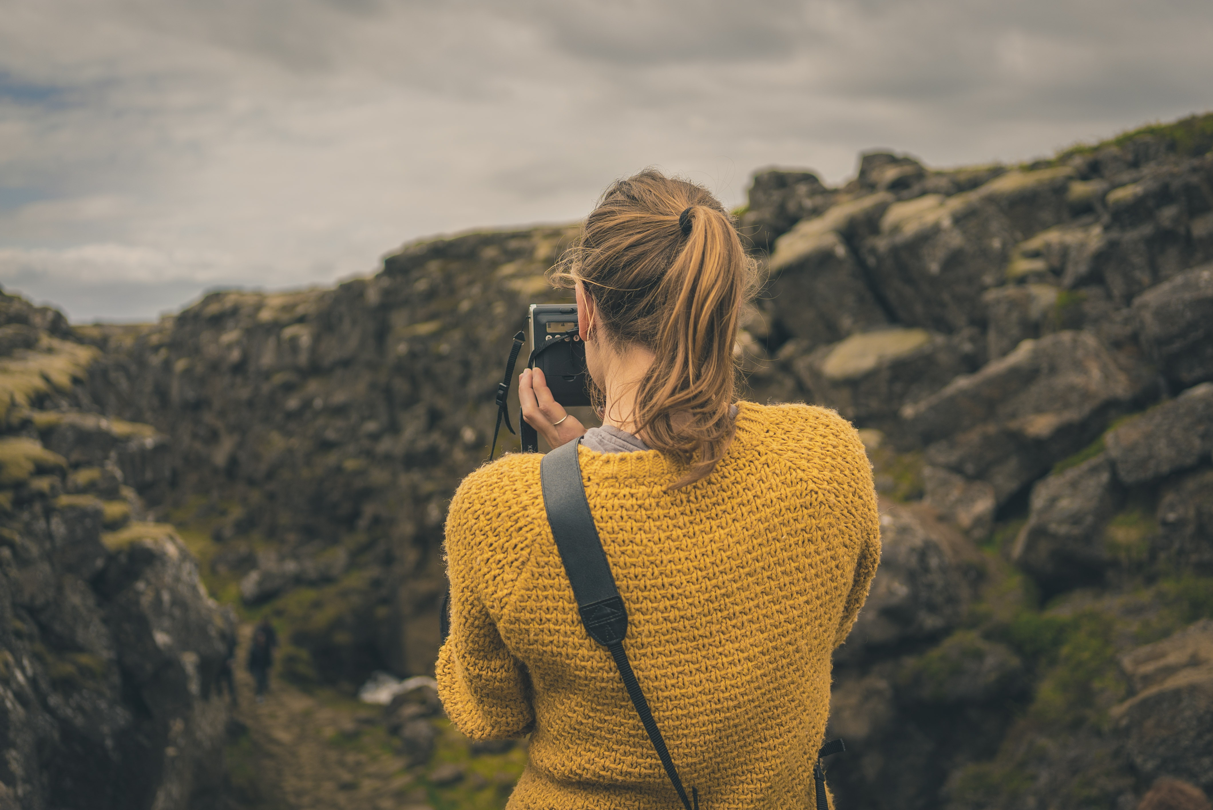 A lady taking a photo during hiking